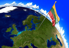 Lithuania national flag marking the country location on world map. 3D rendering, parts of this image furnished by NASA Royalty Free Stock Photography