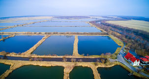 Lithuania ponds aerial. Lithuania from above aerial, fish ponds farm Royalty Free Stock Image