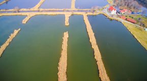 Lithuania ponds aerial. Lithuania from above aerial, fish ponds farm Stock Photos