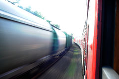 Lithuania Railway Network and Track. Going on Fast Train. Leaving Station. Blurry Train on Oposite Side. Stock Photos