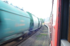 Lithuania Railway Network and Track. Going on Fast Train. Leaving Station. Blurry Train on Oposite Side. Royalty Free Stock Photo