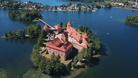 Lithuania. Trakai. Beautiful castle on an island on a lake. Aerial view of Trakai castle in summer season. Trakai castle, Lithuania. Beautiful aerial view in stock video footage