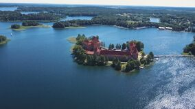 Lithuania. Trakai. Beautiful castle on the lakes. Aerial view of Trakai castle in summer season. Trakai castle, Lithuania. Beautiful aerial view in summer stock video