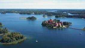 Lithuania. Trakai. Beautiful castle on the lakes. Aerial view of Trakai castle in summer season. Trakai castle, Lithuania. Beautiful aerial view in summer stock video footage