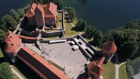 Lithuania. Trakai. Flight over beautiful castle on an island on a lake. Aerial view of Trakai castle in summer season. Trakai castle, Lithuania. Beautiful stock footage