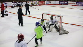 LITHUANIA, VILNIUS - MAY 2015: Goalkeeper pass the puck in game between children hockey teams during a training session on ice of stock video footage