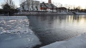 Lithuania, Vilnius river Neris with ice on it. Old town in background stock video