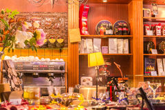 217-06-25, Lithuania, Vilnius, `sokolado namai`, show window with natural tea, cofe, many cakes and candies. Royalty Free Stock Images