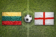 Lithuania vs. England flags on soccer field Stock Photo