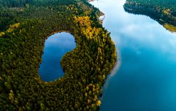 Lithuanian aerial nature. Lakes in forest, aerial photography of beautiful Lithuanian scenic nature in autumn season Stock Image