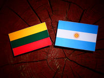 Lithuanian flag with Argentinian flag on a tree stump  Royalty Free Stock Photos