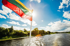 Lithuanian flag. On boat while traveling by the river Stock Photography