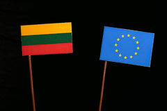 Lithuanian flag with European Union EU flag isolated on black. Background Stock Photography