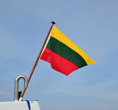 The Lithuanian flag fluttering aft of the ship Royalty Free Stock Image