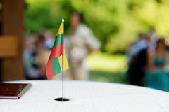Lithuanian flag on a table Royalty Free Stock Image