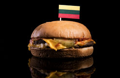 Lithuanian flag on top of hamburger isolated on black Stock Images