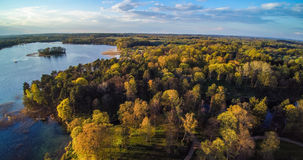 Lithuanian forests from above. Lake and sunset light Stock Image