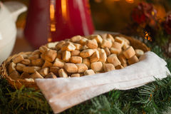 Lithuanian Kuciukai pastries. Basket of traditional Lithuanian Kuciukai pastries served on Christmas Eve, nestling on green pine tree branches royalty free stock photos