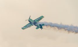The Lithuanian pilot Jurgis Kairys with his colored airplane training in the blue sky Stock Images