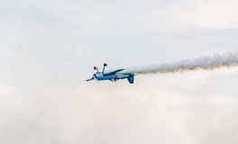 The Lithuanian pilot Jurgis Kairys with his colored airplane training in the blue sky. Stock Image