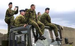 Lithuanian soldiers. Vilnius, Lithuania - May 17, 2014: Lithuanian army soldiers sitting relaxed on the top of military truck during Public and Military Day Stock Images