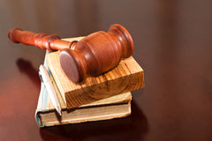 Litigation. Judges gavel, book and pen on the table Royalty Free Stock Images