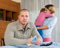 Litigio della famiglia sopra soldi Immagini Stock Libere da Diritti