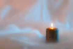 Litl candle. Fancy a lit candle on a shaded background Royalty Free Stock Image