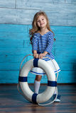 Litl girl holding a life preserver. Looking at camera Stock Images