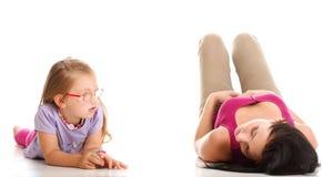 Litle baby girl lying mom Stock Image