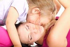 Litle baby laughing toddler girl playing mom doing fun Royalty Free Stock Photos