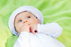 Litle baby lying on floor and looking up Royalty Free Stock Image