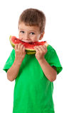 Litle boy eating a watermelon Stock Photography