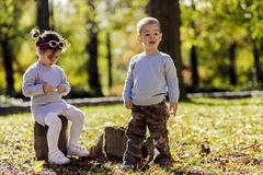 Litle boy and girl at the autumn forest Royalty Free Stock Image