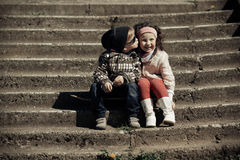 Litle boy kissing girl Royalty Free Stock Photo