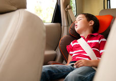 Litle boy sleeps in safe chair Stock Photo