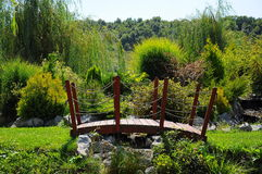 Litle bridge in garden. Splendid bridge in the garden stock image