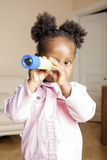 Litle cute sweet african-american girl playing happy with toys at home, lifestyle children concept Royalty Free Stock Photography