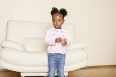 Litle cute sweet african-american girl playing happy with toys at home, lifestyle children concept Royalty Free Stock Photos