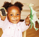 Litle cute sweet african-american girl playing happy with toys at home, lifestyle children concept Royalty Free Stock Image
