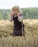 Litle gilr playin in a wheat field Stock Images