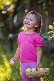 Litle girl with apples Royalty Free Stock Image