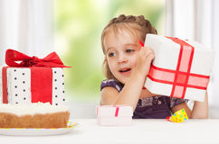 Litle girl with birthday cake Royalty Free Stock Images