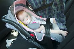 Litle girl in car seat Stock Photo