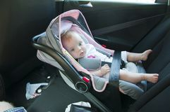 Litle girl in car seat Stock Image