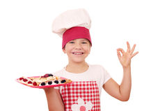 Litle girl with crepes on plate and ok hand sign Royalty Free Stock Photo