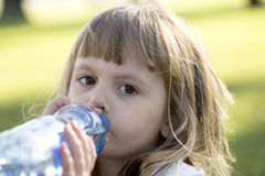 Litle girl drink water Royalty Free Stock Images