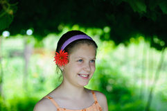 Litle girl with flower. Portrait of cute young girl with flower royalty free stock image