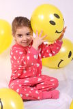 Litle girl and her balloons. 3 year odl girl playing with smiling baloons royalty free stock photo