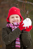 Litle girl making snowballs Royalty Free Stock Images